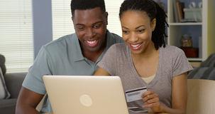 couple shopping on laptop