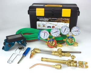 Complete oxy-fuel cutting and welding kit with accessories and cutting tips