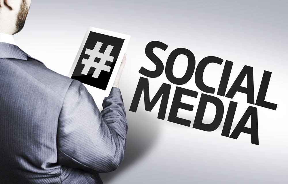 Business man with the text Social Media in a concept image.jpeg