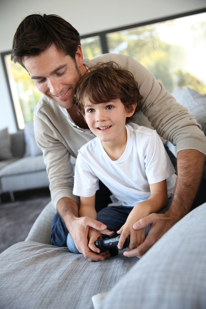 Daddy with kid playing video game.jpeg