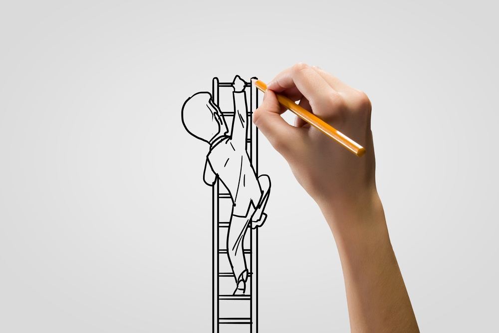 A hand drawing a caricature, an element of Motion and Graphics Deisgn