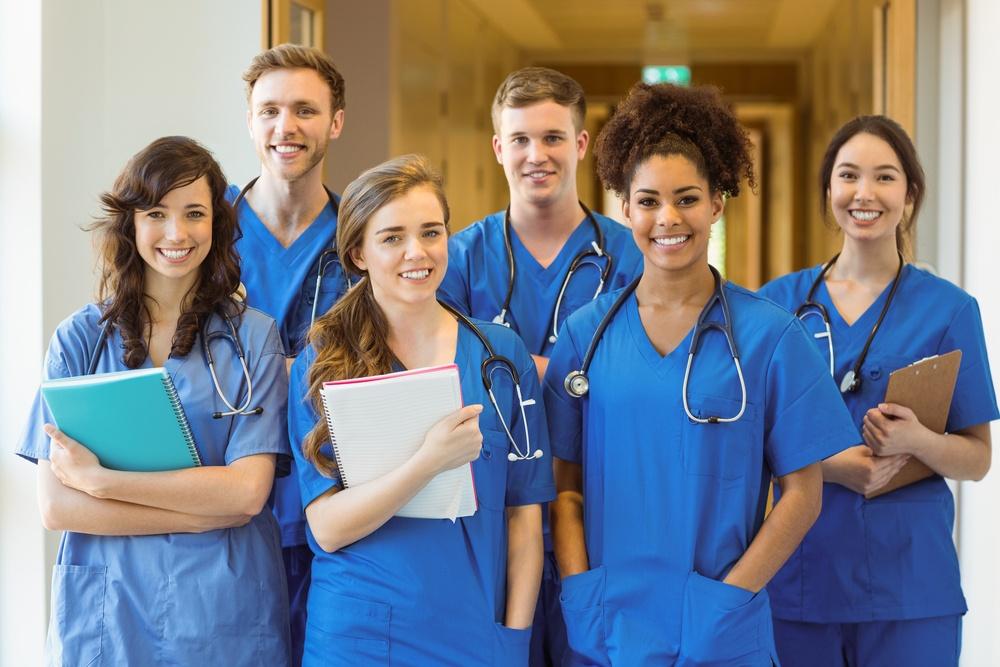 Medical students smiling at the camera at the university-1.jpeg