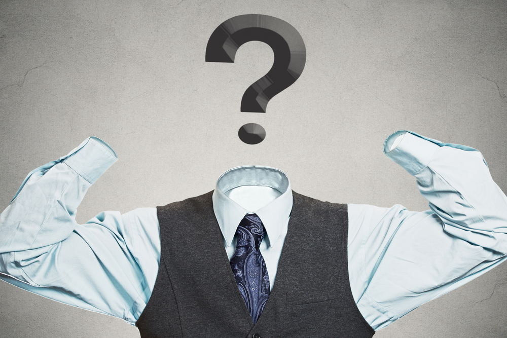Desperate businessman with question mark instead of head has no hands tools to solve multiple financial issues isolated grey wall background. Corporate problems lack of solutions concept. Hopelessness