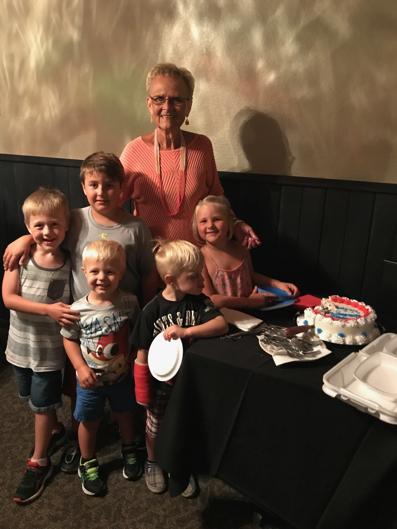 Sue Olson with some of her eight grandchildren.