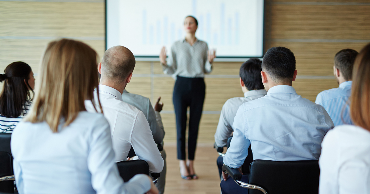 woman-presenting-to-businesspeople