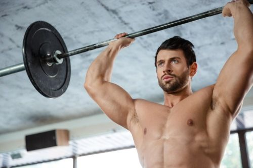 portrait-of-a-muscular-man-workout-with-barbell-in-fitness-gm_BFms0TTHj-compressor.jpg
