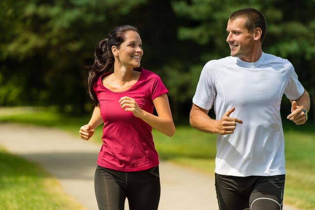 cheerful-caucasian-couple-running-outdoors-compressed.jpg