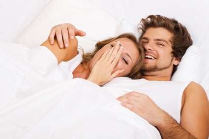 couple-in-bed-laughing.jpg