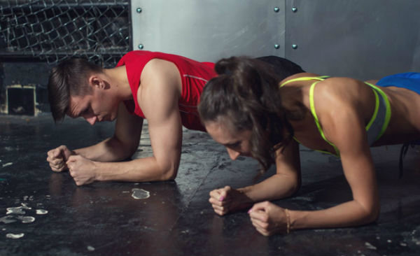 fit-sportive-man-and-woman-doing-plank-core-exercise-training-back-press-muscles-xs