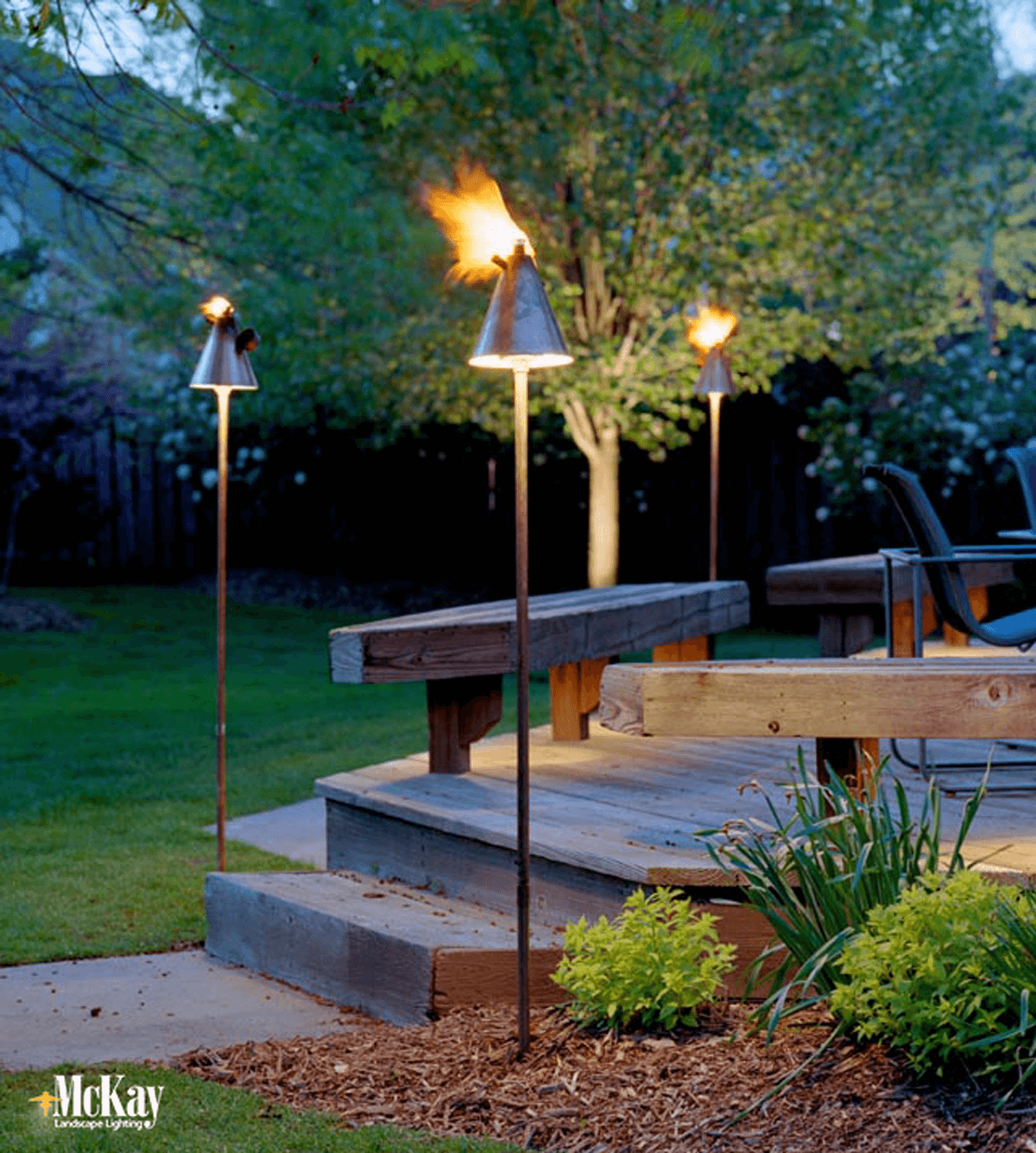 Unique lighting ideas tiki torch lights add a vacation for Unique patio lighting ideas