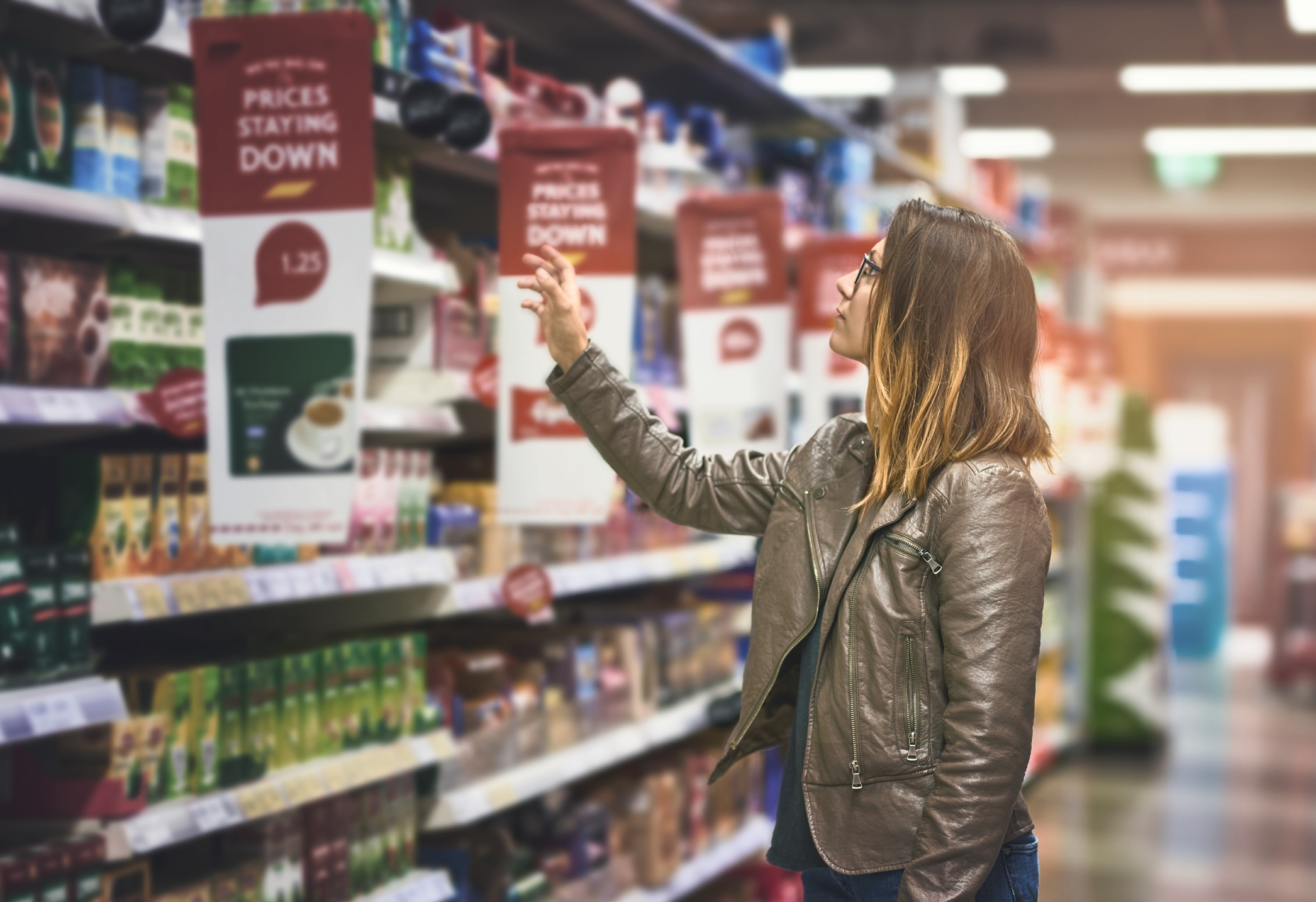woman shopping in grocery store iStock-926538802
