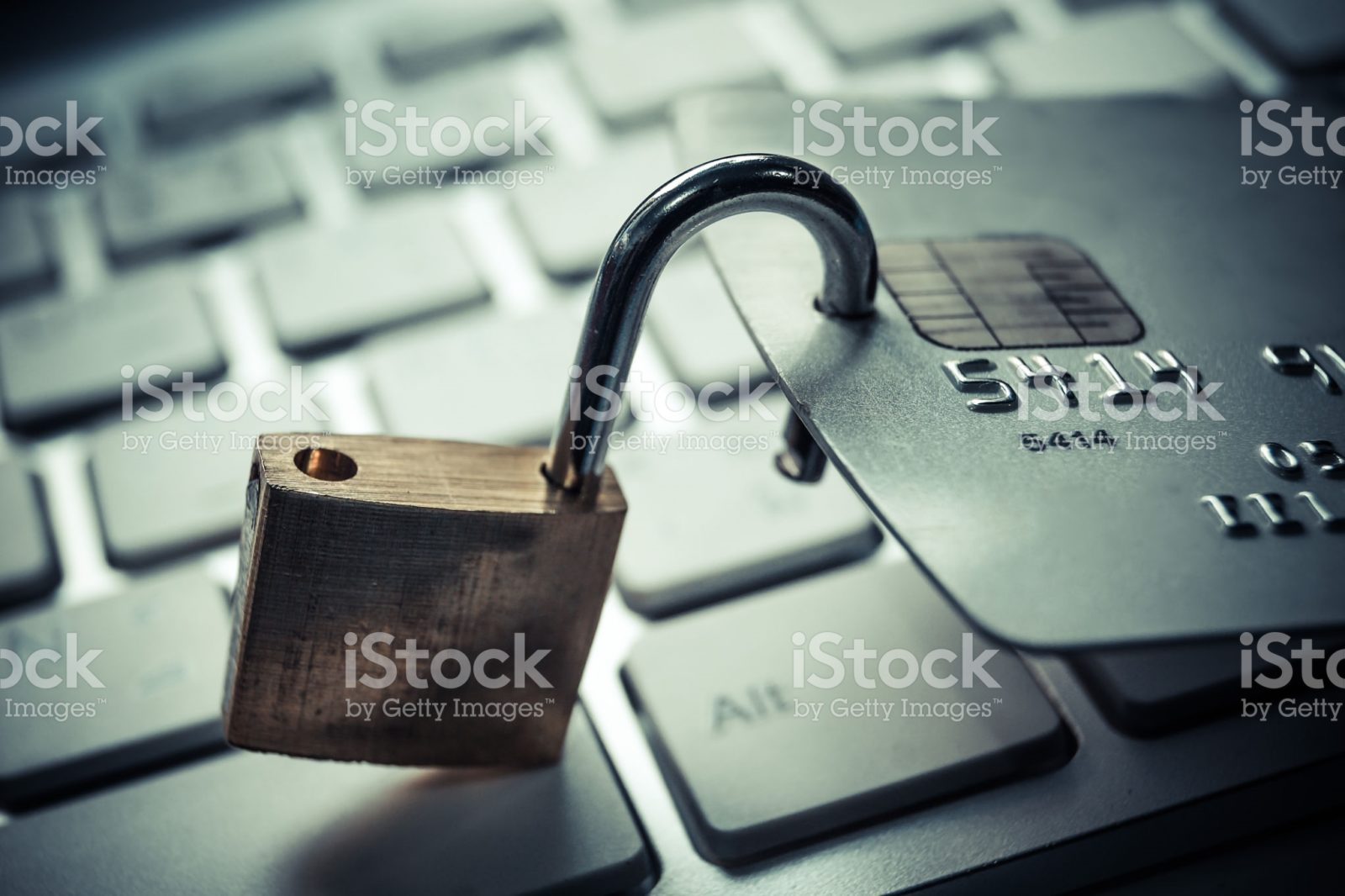 Credit card with unlocked padlock