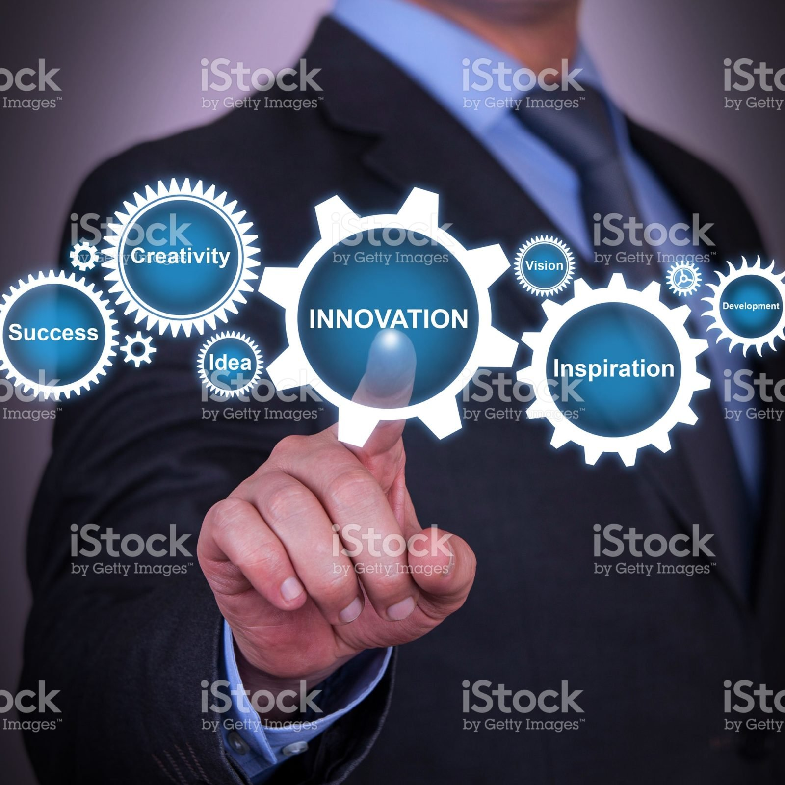 Businessman with his finger on innovation