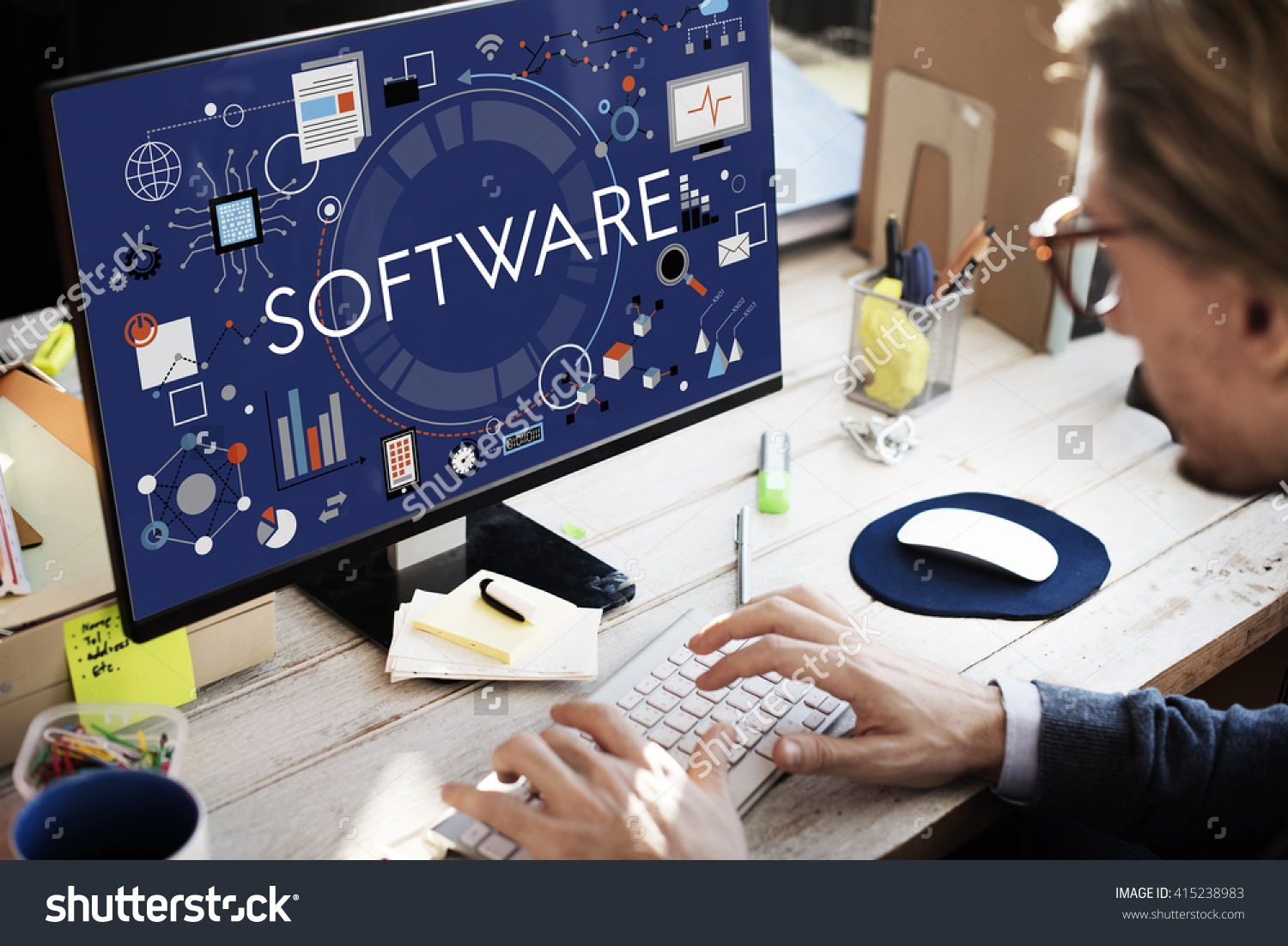 Man using computer screen that says software