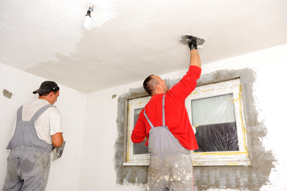 Construction workers painting walls-1