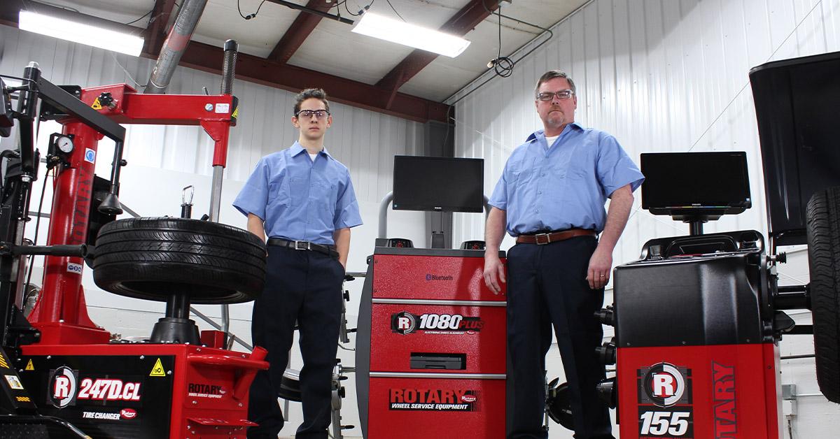 Technicians with wheel service equipment