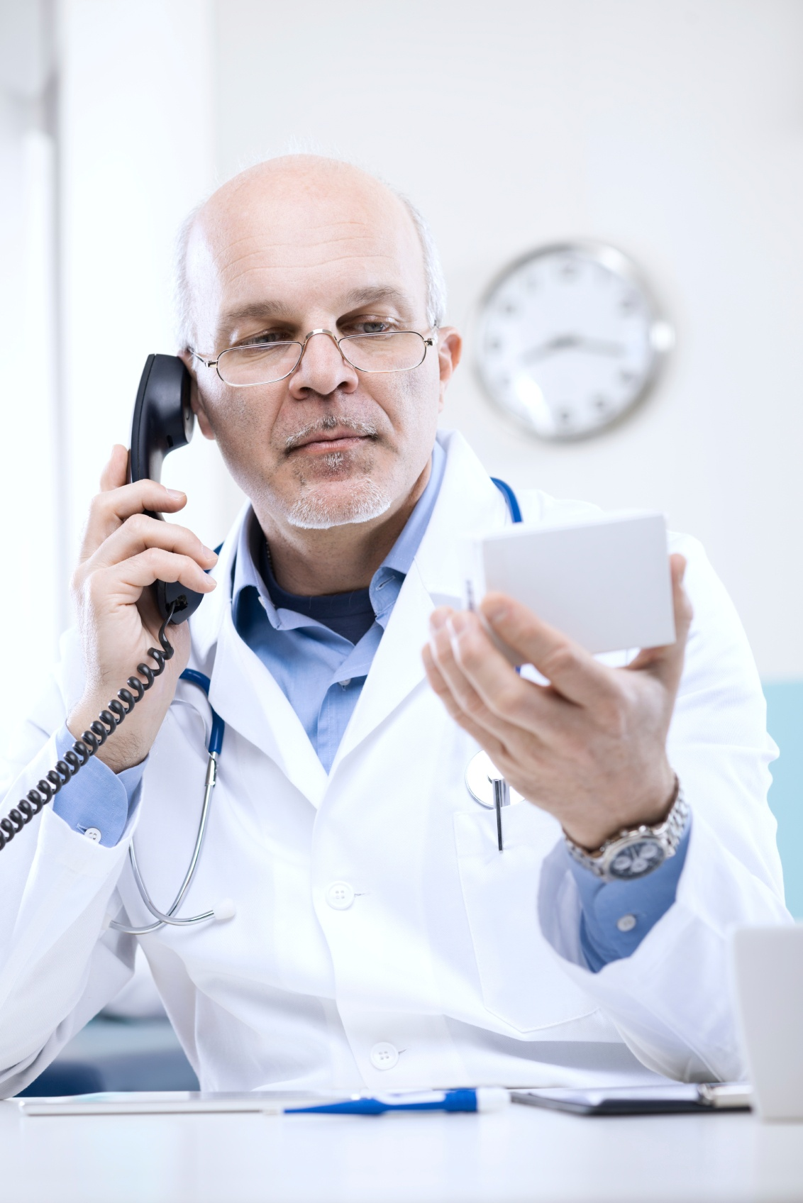 Doctor-on-the-phone-000042293804_Medium