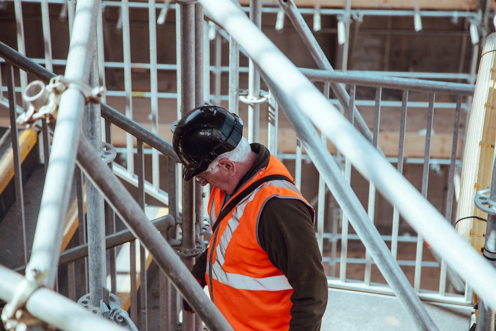 An image of a construction worker. Conduct frequent check-ins with your employees to understand their attitude toward your business.