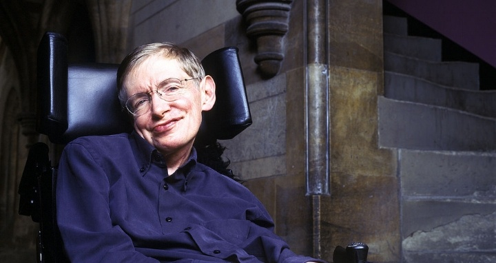 Stephen Hawking seated intellectual genius