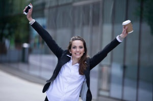 Portrait of a very happy business woman celebrating good news.