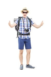 Young tourist giving thumbs up