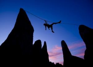 Climber on a tyrolean traverse.