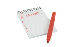 Red marker and notebook isolated over white