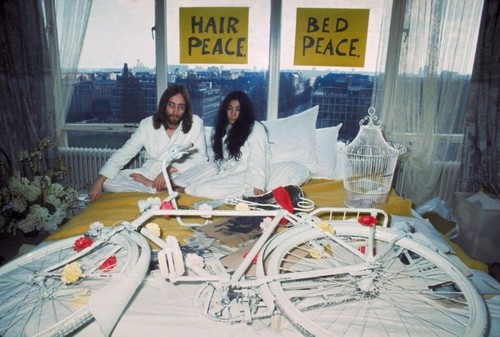 John Lennon and Yoko Ono with white bike - CLARA blog