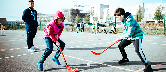 Premier children playing Hockey on a Premier Camp
