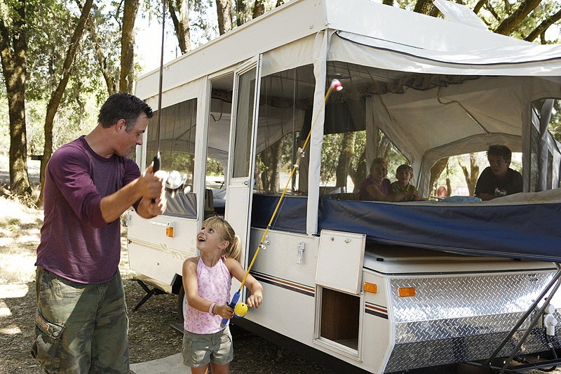 Father-and-daughter-with-folding-camper-web.jpg
