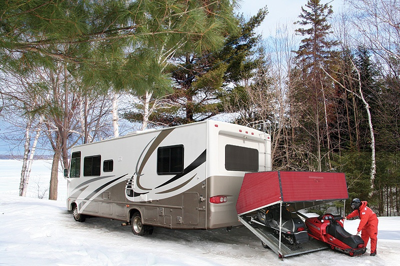 Snowmobiles attached to RV