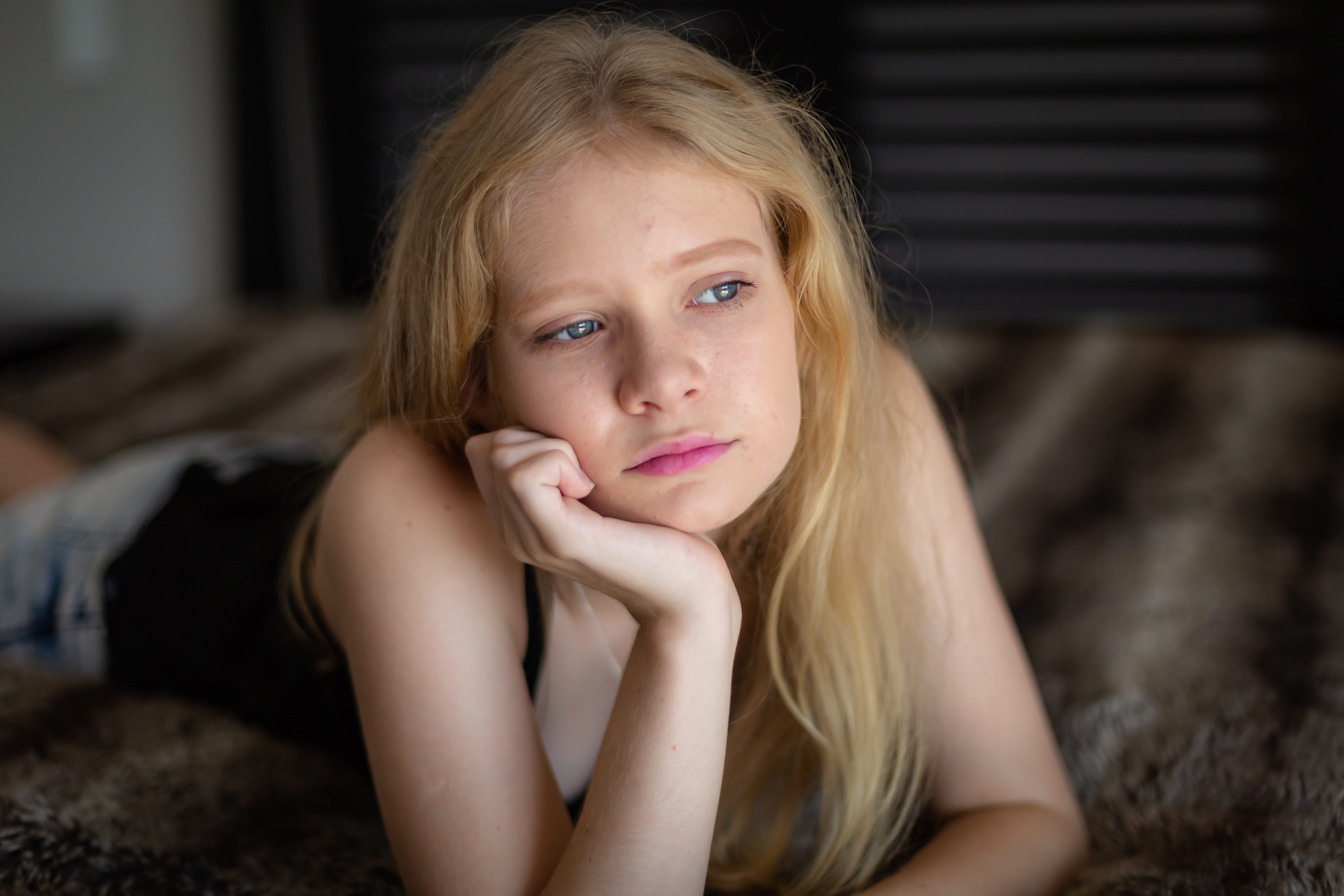 Teen girl gazes out of the window