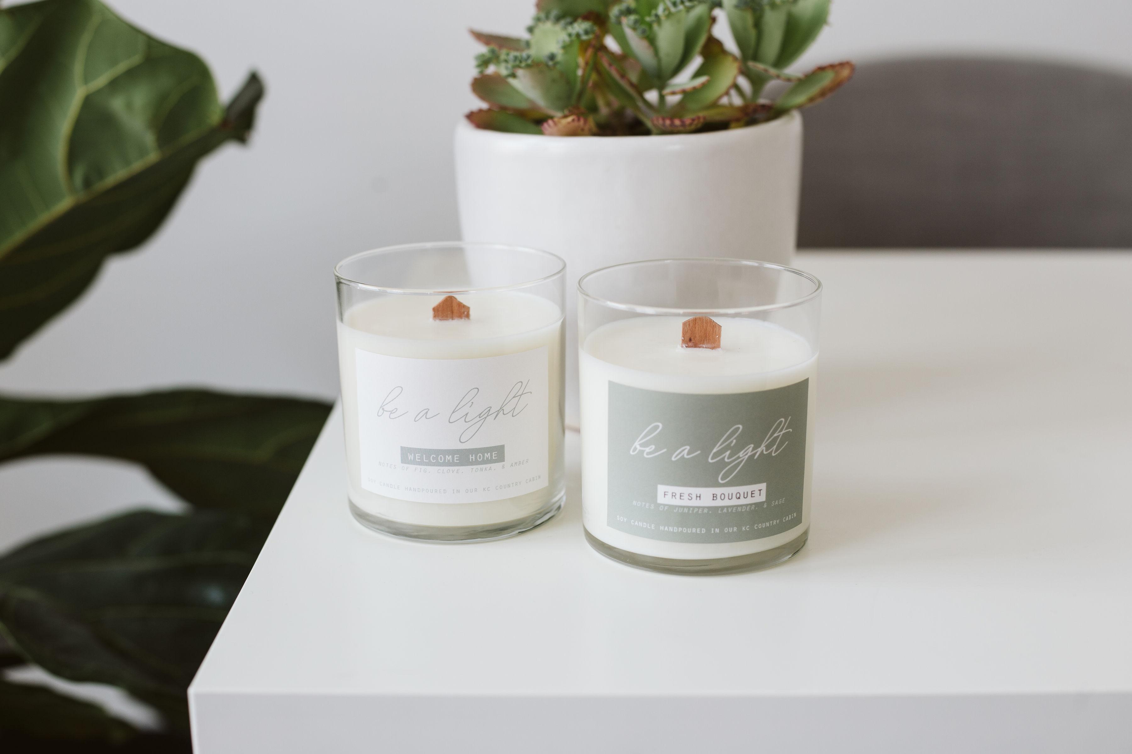 """Continue Good """"Be a Light"""" candles on a table"""