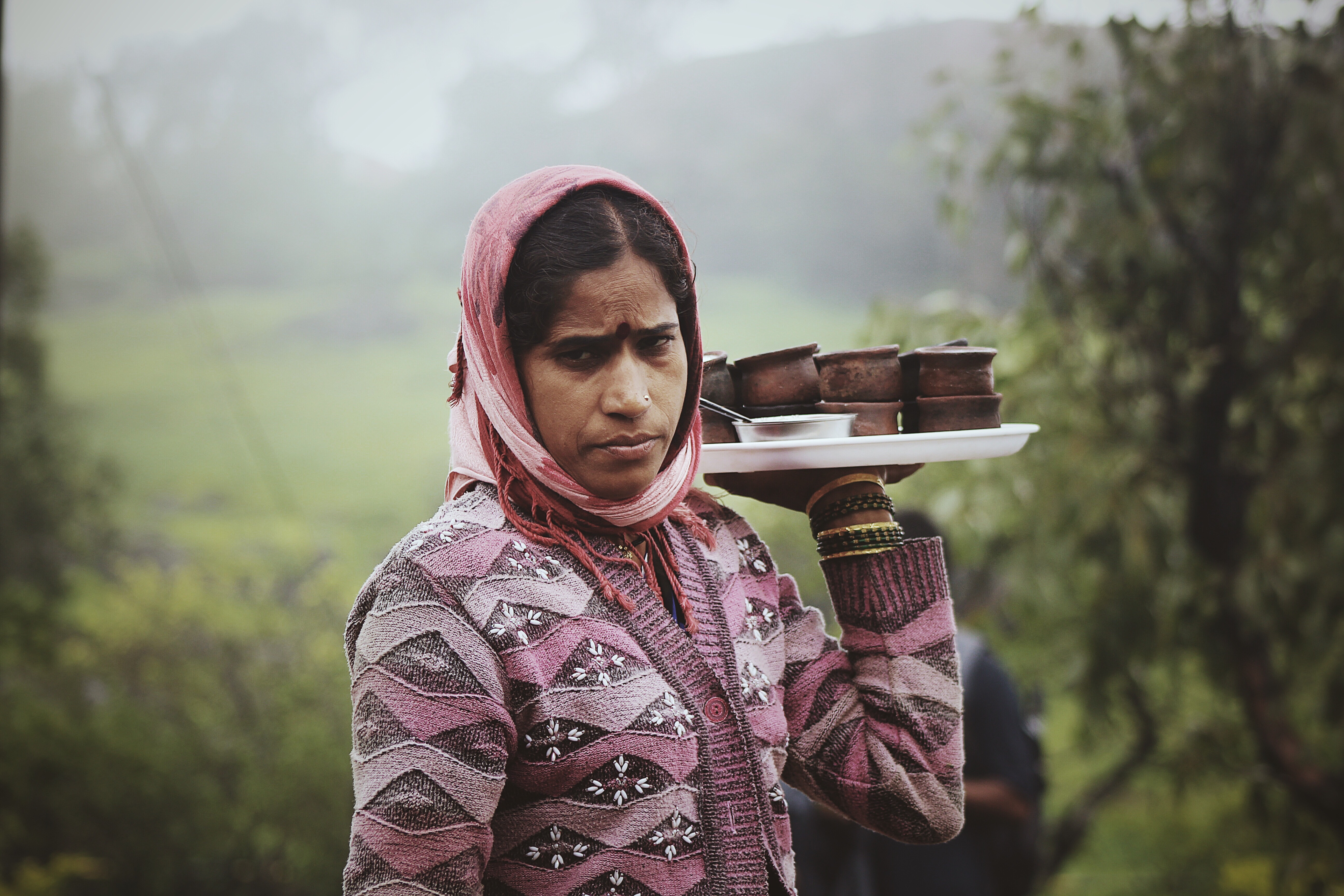 Indian woman selling yogurt in clay pots