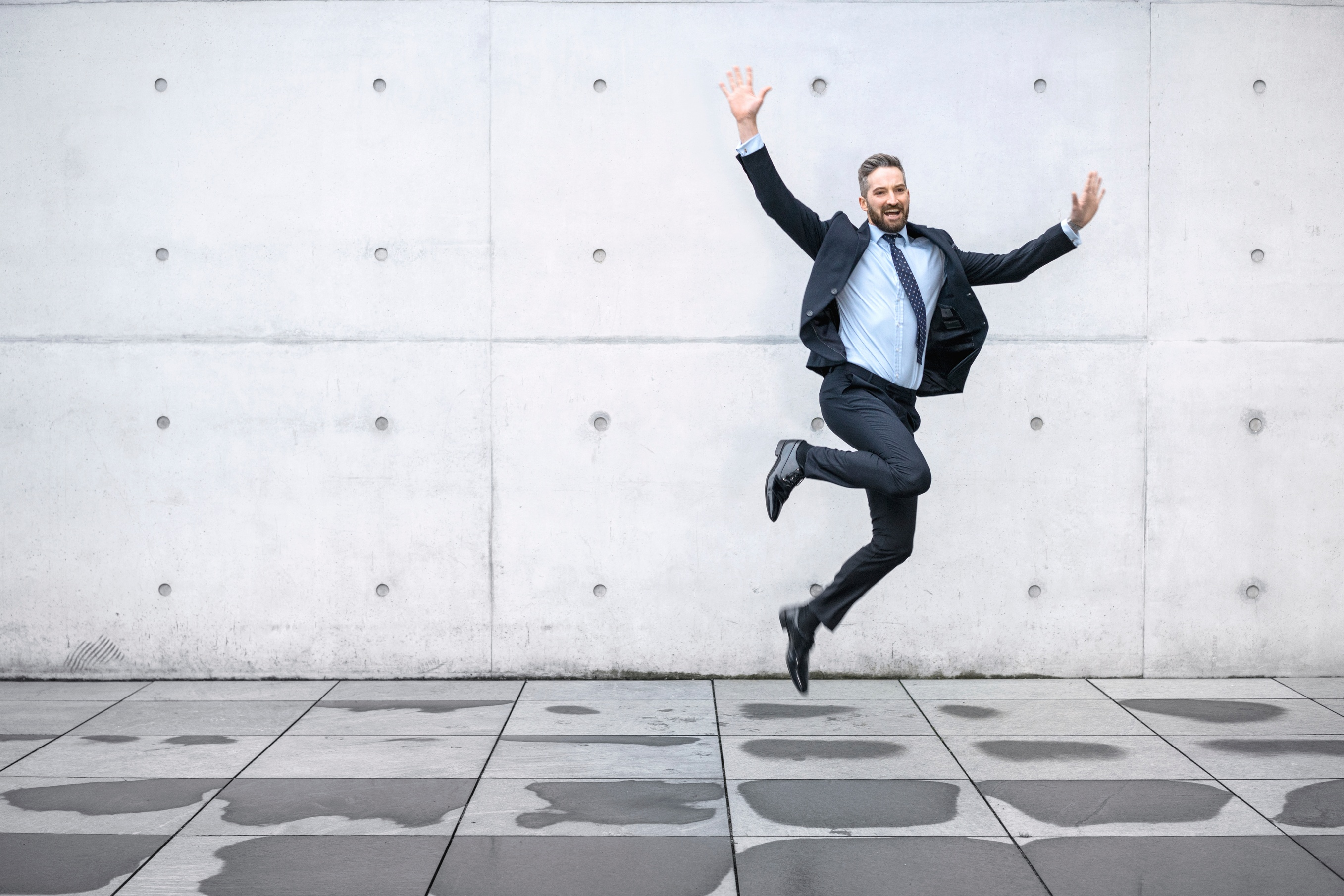 happy-businessman-jumping-in-air-000096548261_Large.jpg