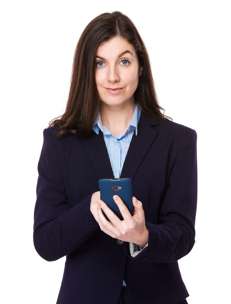 Brunette businesswoman using smart phone