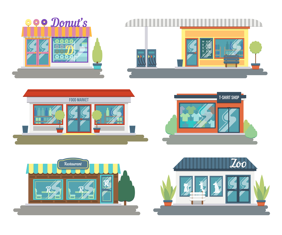 Storefronts with donut shop, food market, gas station and t-shirt shop