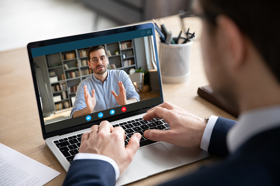 Virtual Remote Worker Male Man talking online with another man
