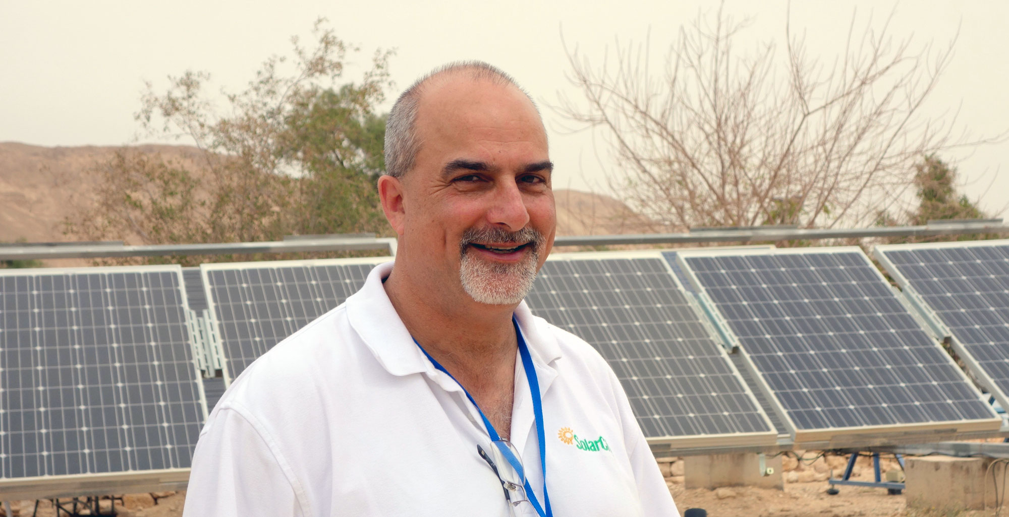 photo of David Arfin in front of a solar installation
