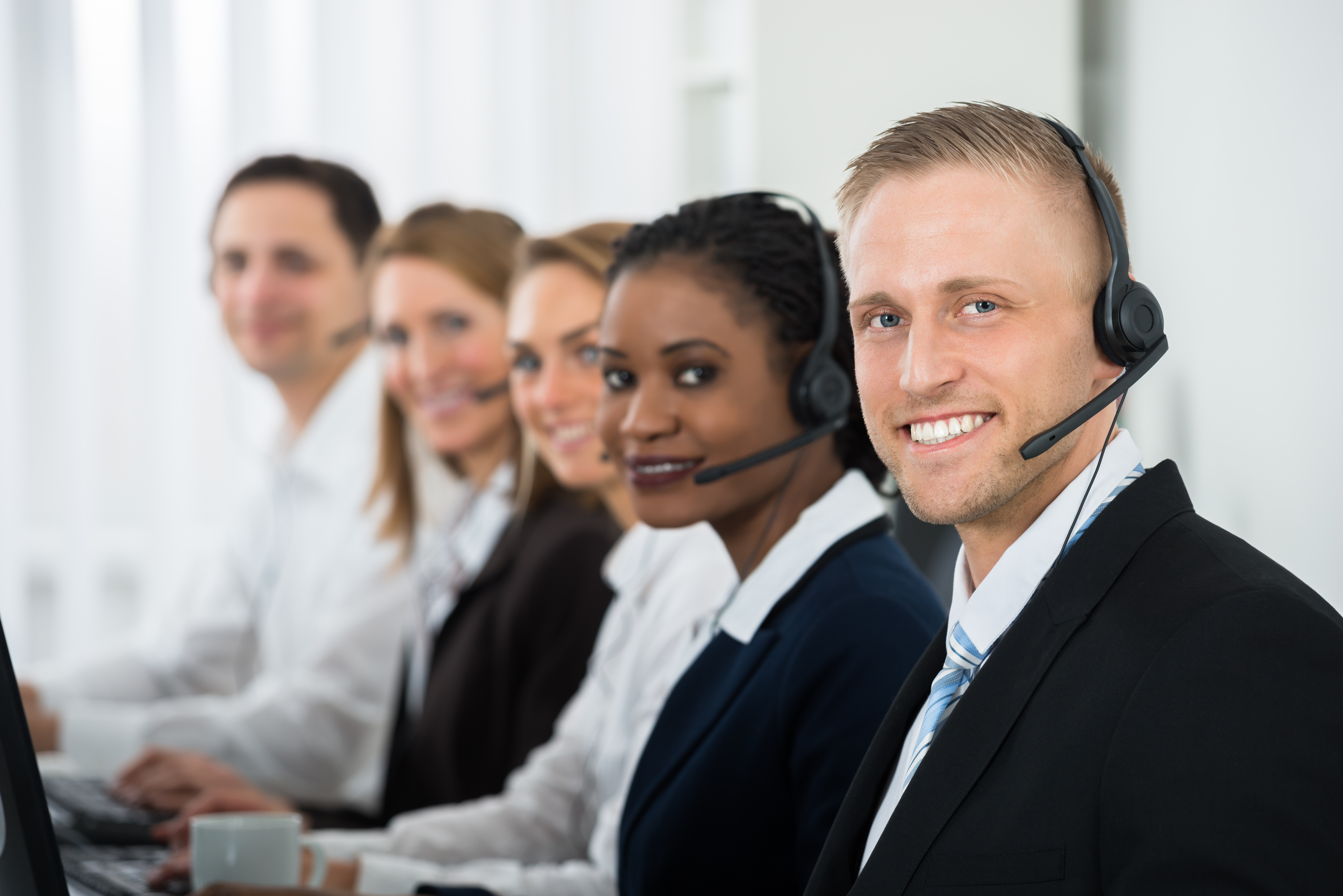 Call center agents in formal attire.