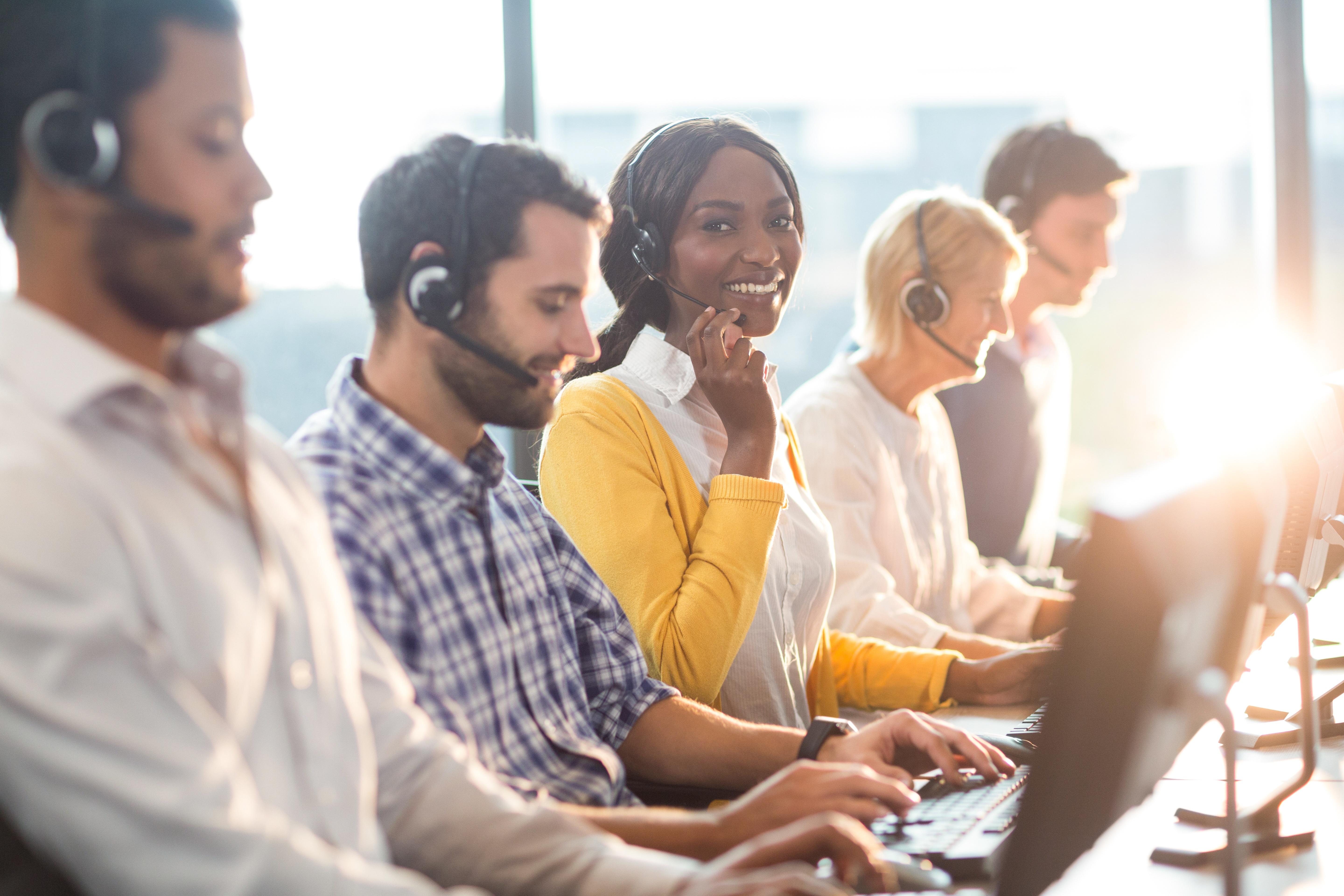 Picture of retail call center agents smiling.