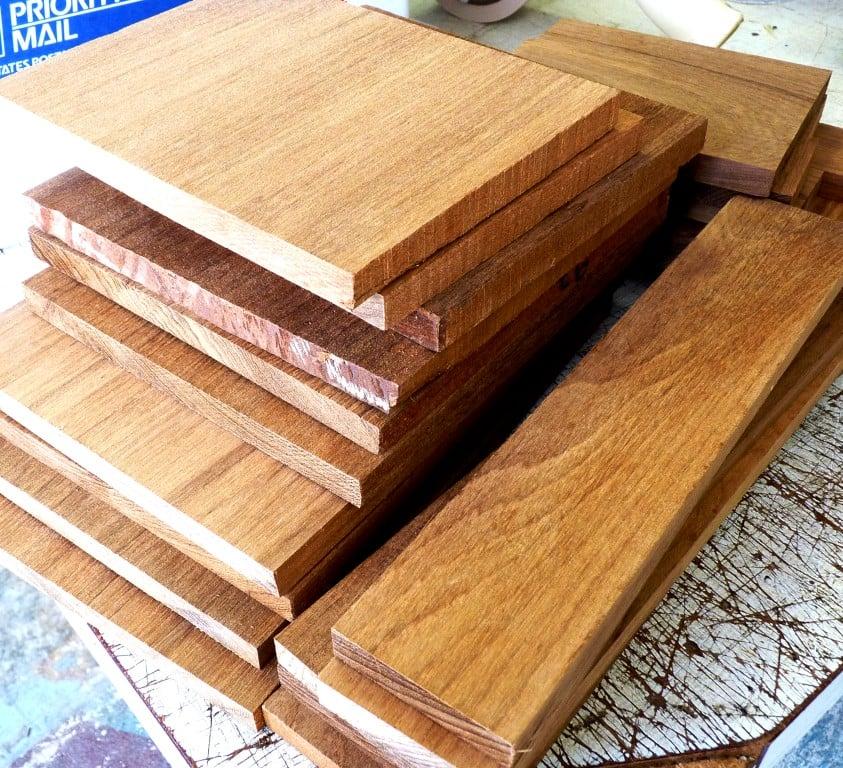 Stacked planks of teak lumber