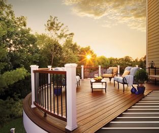 Sun setting over a furnished deck