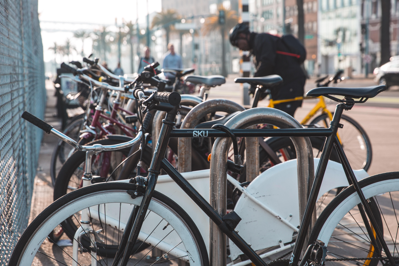 man-commuting-by-bike-parking