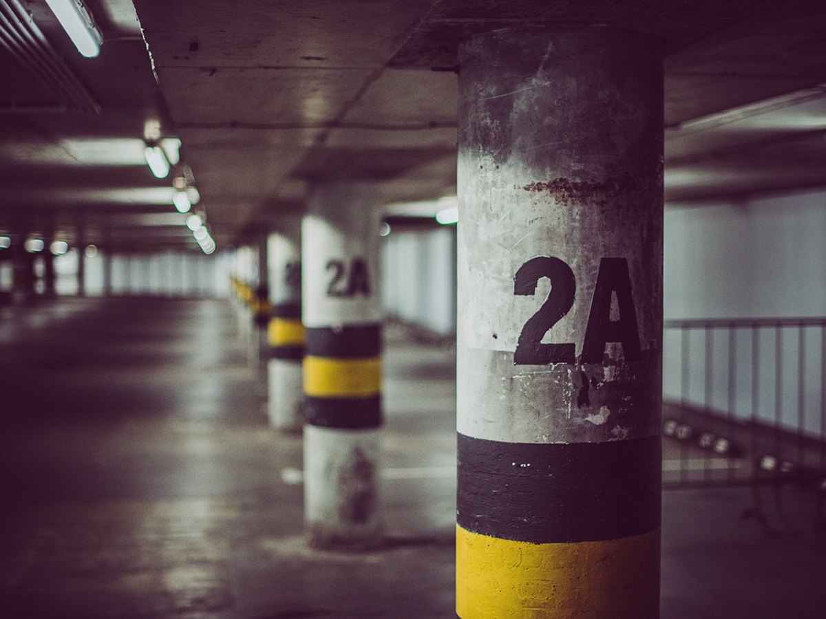 garage-lot-parking-empty-spaces-employee-employer-tax-money-benefits