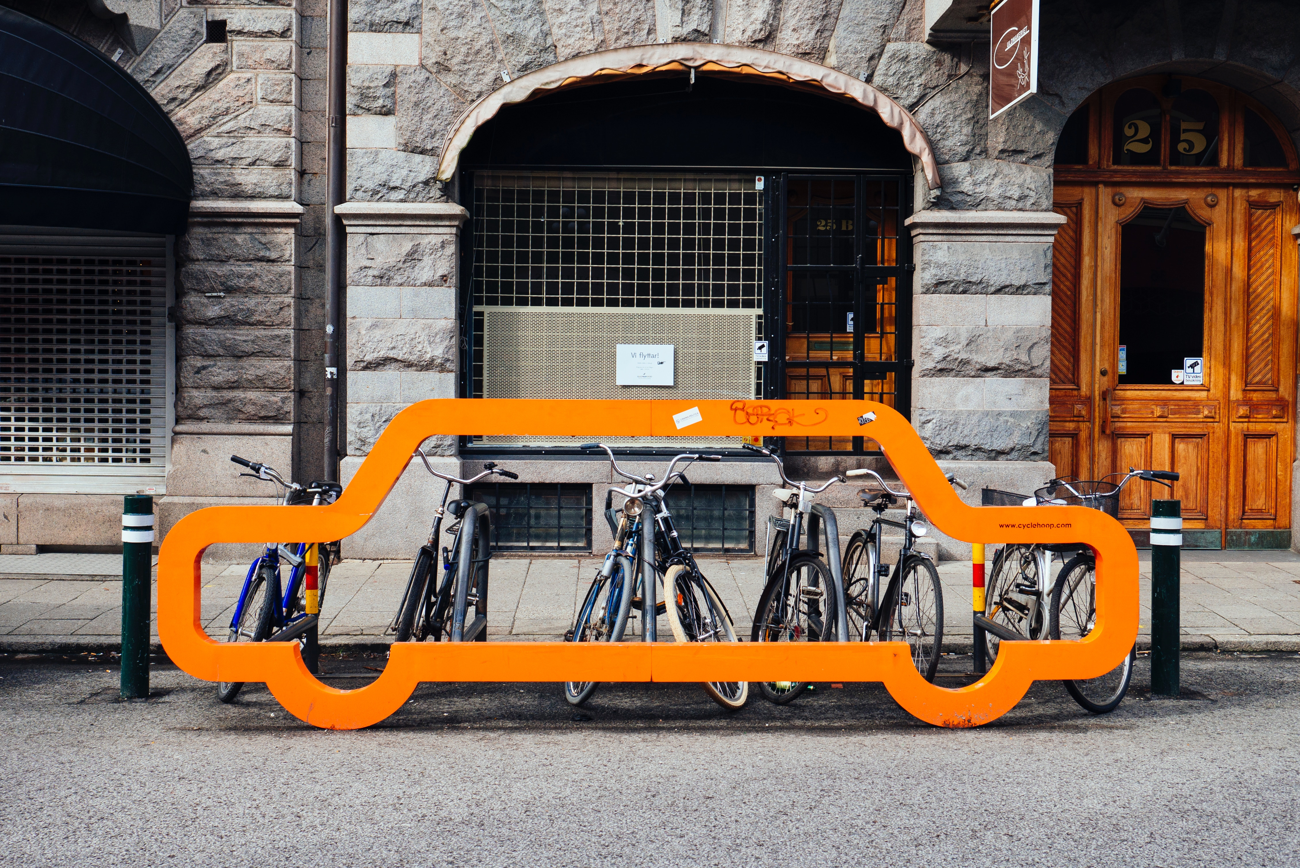 Designated curb management spaces for bikes in a city