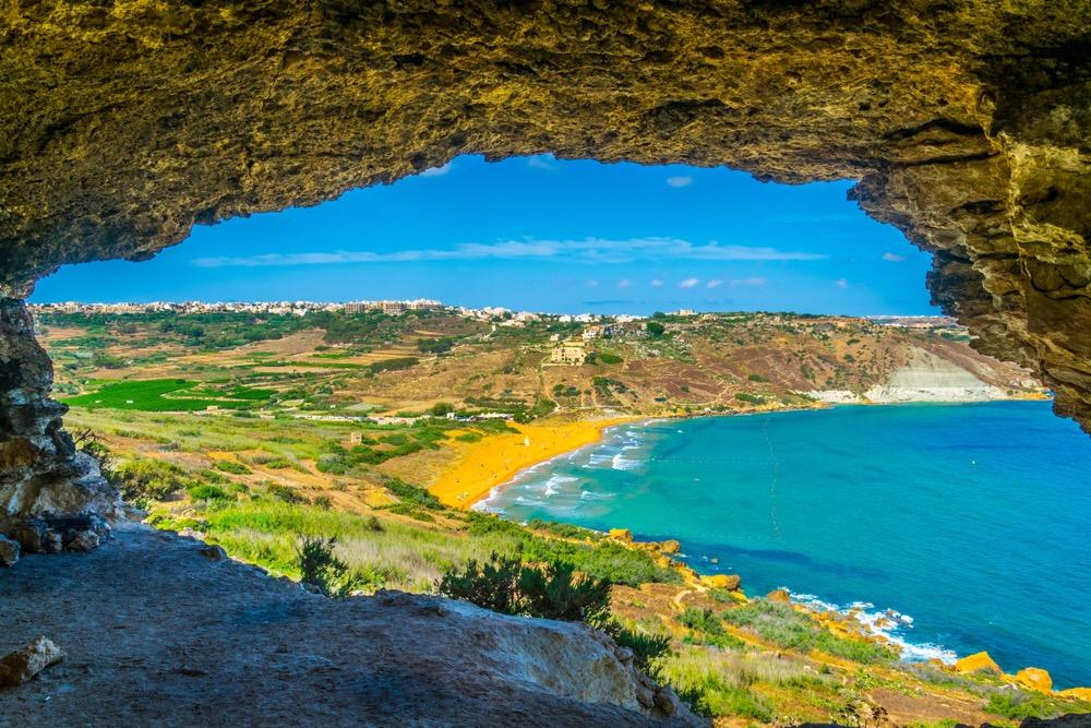 view from a cave over the ocean in Ramla Lhamra, Gozo, Malta