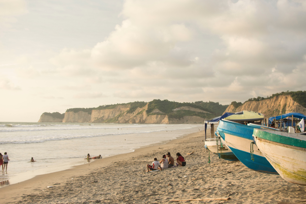 chill beach on the coast of Ecuador with old wooden fishing boats
