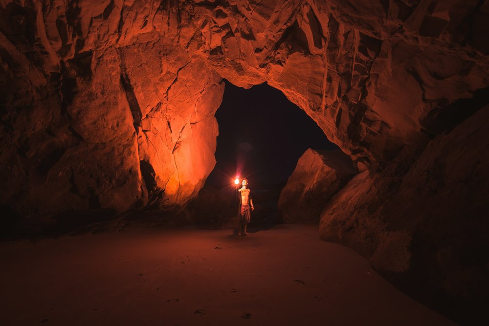 cave illuminated by explorer