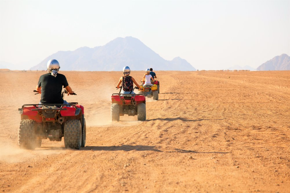 group ATV'ing through the desert in baja california todos santos